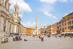 Rome, Italy - May 30, 2018: Piazza Navona Square on a Sunny summer day. Tourists and musicians on a typical Roman square. Piazza Navona Square on a Sunny summer royalty free stock photo