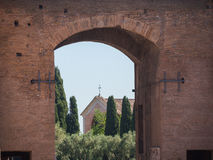 Rome, Italy, 12 may 2015, roman ruins in a sunny day - ancient arch and church. Telephoto Stock Image