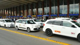 Rows of white taxis waiting for customers at Termini Railway Station. Rome, Italy - May 2018: Rows of white taxis waiting for customers at Termini Railway stock footage