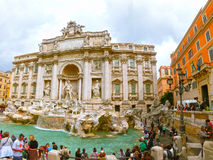 Rome, Italy - May 02, 2014: Tourists visiting the Trevi Fountain. Stock Image