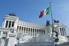 Rome Italy Modernist Architecture of Trajan's Forum. Italian flag flies over the dramatic architecture of the modernist white marble Altere della Patria, also royalty free stock image