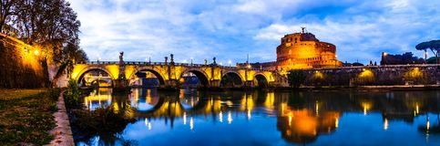 Panoramic night view of Castle Saint Angelo in Rome, Italy royalty free stock photography