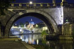 Rome. Italy. Night view of the city in the illumination from under the bridge over the Tiber River.  stock photography