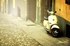 Rome, Italy - November 14, 2017: Group of Scooter Vespa parked on old street in Rome, Italy. Rome, Italy - November 14, 2017: Citizens most commonly use scooter Royalty Free Stock Photography