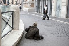 Elder woman homeless in the street. Rome, Italy - November 18, 2017 , Elder woman homeless in the street Royalty Free Stock Photography
