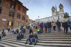 ROME ITALY - NOVEMBER 8 : large number of tourist sitting on spa Royalty Free Stock Images