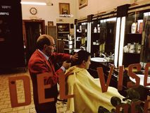 Barber cuts her hair men client Royalty Free Stock Photo