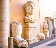 ROME, ITALY- OCTOBER 10, 2017- Emperor Constantine in the Capito. Line Museum:  Parts of a giant marble scultpure in the courtyard of the Palazzo dei Stock Photography