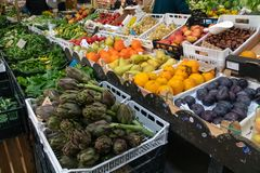 Fruits and vegetables for sale. Rome, Italy - October 31, 2018: Farmers` market: Heap of fresh fruits and vegetables stock photography