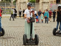 Rome, Italy-October 07, 2018, girl guide Segway City tour on Segway near Colosseum.  royalty free stock photo