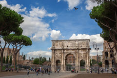 Rome, Italy - 17 october 2012: Tourists walking near Constantine. 's arc in Rome - triumphal arch in Rome, situated between the Colosseum and the Palatine Hill Royalty Free Stock Photos