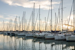 Rome, Italy - October 2015: Yachts and boats docked at the pier in the sea at the port of Rome in Italy at sunset in calm sunny Royalty Free Stock Image