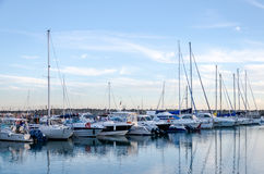 Rome, Italy - October 2015: Yachts and boats docked at the pier in the sea at the port of Rome in Italy at sunset in calm sunny Royalty Free Stock Photo