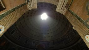 Rome Italy Pantheon popular tourist destination in Rome. The Dome Of The Pantheon. A light beam shines from the roof of stock footage