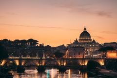 Rome, Italy. Papal Basilica Of St. Peter In The Vatican And Aelian Bridge In Sunset Sunrise Time. Rome, Italy - October 19, 2018: Papal Basilica Of St. Peter In royalty free stock image
