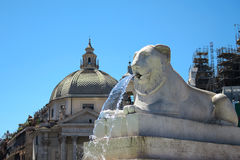 Rome Italy. Piazza del Popolo square lion fountain. Stock Photos