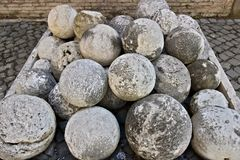 Cannon balls in white marble. A pile of marble balls used for ca royalty free stock images