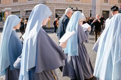 ROME-ITALY-24 10 2015, religious procession through the streets. Of Rome and the Vatican priests, nuns and monks praying to walk the stalls of Roma, Pilgrimage royalty free stock photography