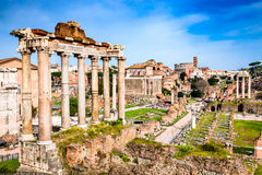 Rome, Italy - Ruins of Imperial Forum. Rome, Italy.  Sunset view with ruins of Imperial Forum, Roman Empire. Background with Colosseum (Colosseo or Coliseum Royalty Free Stock Image