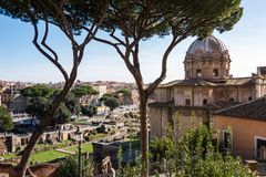 ROME, Italy: Scenic View of Ancient Roman Forum, Foro Romano, and St Joseph Church royalty free stock images