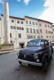 ROME, ITALY- September 10, 2016: The blue old retro car Fiat parked on the street of Rome stock photos