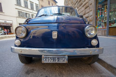ROME, ITALY- September 10, 2016: The blue old retro car Fiat parked on the street of Rome stock image