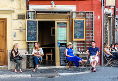 Rome, Italy - September 15, 2016: People in cafe in roma are having a pleasant time royalty free stock photos