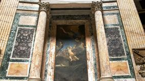 ROME, ITALY- SEPTEMBER 29, 2015: shot of a painting and columns in the pantheon stock photography