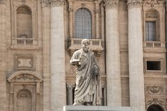 Rome, Italy - September 13, 2017: The statue of St. Peter, who holds the key to heaven. St. Peter`s Basilica in the background. stock images