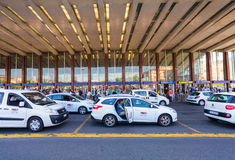 Rome, Italy - September 12, 2016: Taxi cars are  near the taxi stop and queue from people at  entrance of Termini Train Station Stock Photo