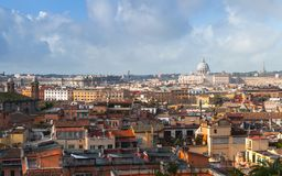 Rome, Italy. Skyline with roofs and churches. Rome, Italy. Skyline with roofs and The Papal Basilica of St. Peter in the Vatican on the horizon, photo taken from royalty free stock photos