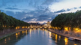 Rome, Italy: St. Peter's Basilica, Saint Angelo Bridge and Tiber River after the sunset day to night timelapse stock video