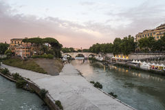 Rome Italy summer 2016. Tiber Island (Isola Tiberina) evening view. This small island can be visited in the center of Rome on the river Tiber by the Trastevere royalty free stock images