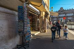 11/09/2018 - Rome, Italy: Sunday afternoon in the city center, f. Amily of tourists walking by souvenir shop in Rome at Piazzale Flaminio royalty free stock photography