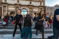 11/09/2018 - Rome, Italy: Sunday afternoon in the city center,people crossing road at piazzale flaminio. Center figure is. A gyspy beggar stock photo