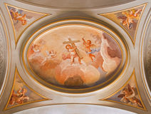 ROME, ITALY, 2016: The symbolic fresco of angels with the cross on the ceiling of sinde nave in church Basilica di Santi Giovanni Royalty Free Stock Photo