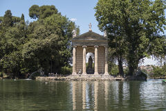 Rome Italy. Temple of Asclepius (Tempio di Esculapio) at Villa Borghese gardens. Visitors can rent boats to row for a limited time at the small lake by the stock photography