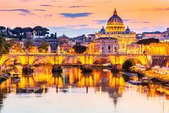 Rome, Italy. Vatican City. Saint Peter Basilica and Sant`Angelo Bridge, over Tiber river. Rome, Italy royalty free stock photos