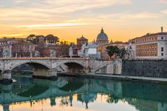 Rome, Italy. Vatican dome of Saint Peter Basilica or San Pietro and Sant`Angelo Bridge over Tiber river royalty free stock images