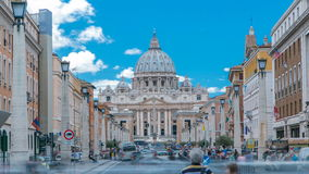 Rome, Italy, Vatican timelapse: St. Peter's Basilica in Vatican City State view from Via della Conciliazione, Road of. The Conciliation. Blue cloudy sky with stock video footage