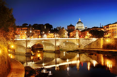 Rome, Italy - view of a bridge over Tiber river and St. Peter's Basilica dome in Vatican at night Stock Image