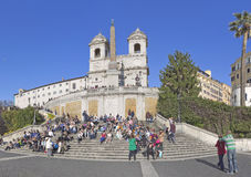 Rome landscape. ROME, ITALY - MARCH 28, 2014: People are resting on the famous Spanish Steps, which lead to the Piazza Trinita  dei Monti Stock Image