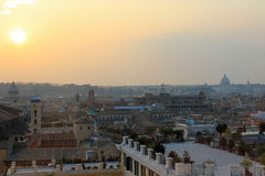Rome sunset, s.peter basilica. Lovely view from the Quirinal Hill in Rome in the background S. Peter and some of the churches of Rome highest Royalty Free Stock Photos