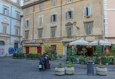 Scene in a square in Rome royalty free stock photography