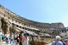 Rome, Lazio, Italy. July 25, 2017: Interior views of the Roman C. Oliseum with many people visiting the interior Royalty Free Stock Image