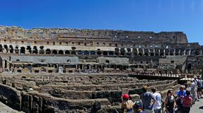 Rome, Lazio, Italy. July 25, 2017: Interior views of the Roman C. Oliseum with many people visiting the interior Royalty Free Stock Images