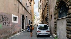 Rome, Lazio, Italy. July 25, 2017: Narrow cobblestone street in