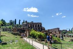 Rome, Lazio, Italy. July 25, 2017: Partial view of the ruins of. The forum of the time of the Roman Empire, with tourists visiting it Royalty Free Stock Photography