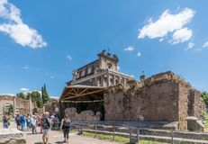 Rome, Lazio, Italy. July 25, 2017: Partial view of the ruins of. The forum of the time of the Roman Empire, with tourists visiting it Royalty Free Stock Photo