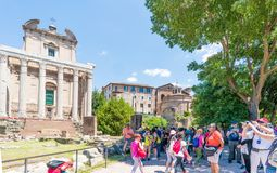 Rome, Lazio, Italy. July 25, 2017: Partial view of the ruins of. The forum of the time of the Roman Empire, with tourists visiting it Royalty Free Stock Image